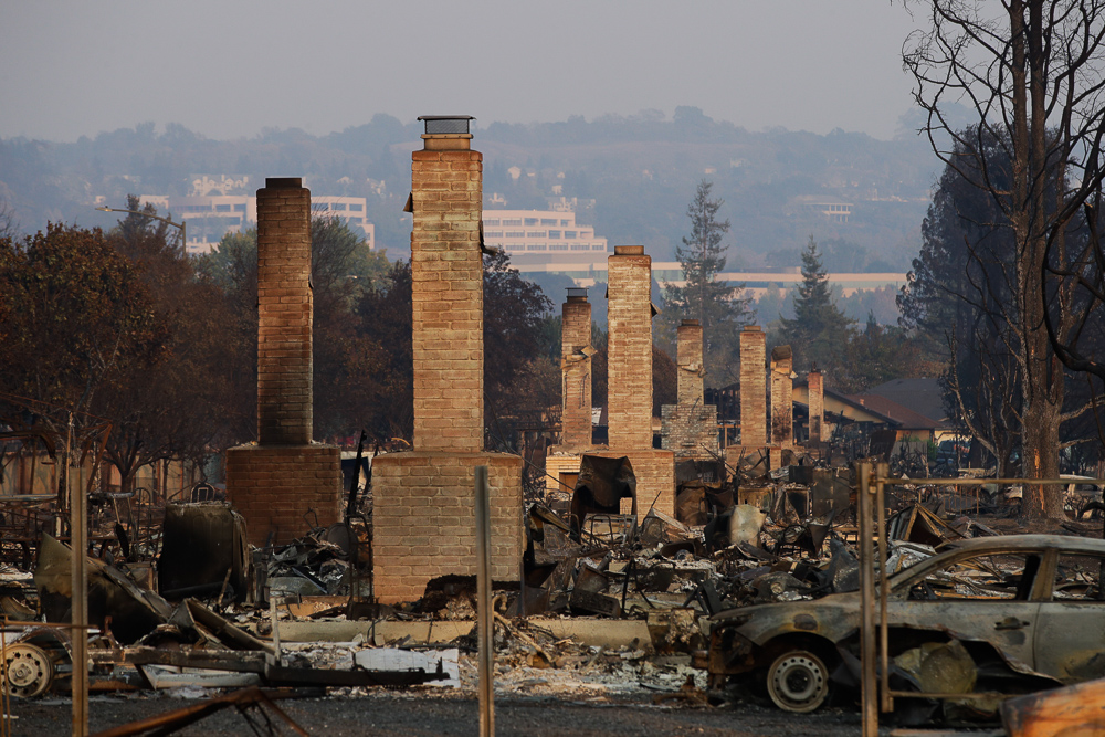 <div class='meta'><div class='origin-logo' data-origin='none'></div><span class='caption-text' data-credit='Jae C. Hong/AP Photo'>A row of chimneys stand in a neighborhood devastated by a wildfire Friday, Oct. 13, 2017, near Santa Rosa, Calif.</span></div>
