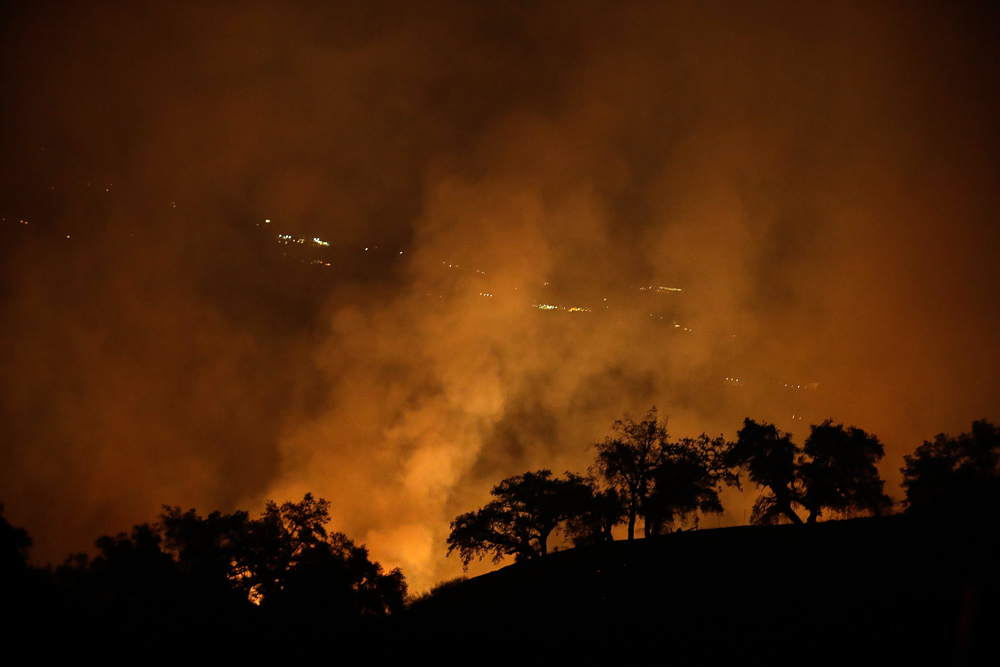 <div class='meta'><div class='origin-logo' data-origin='none'></div><span class='caption-text' data-credit='Marcio Jose Sanchez/AP Photo'>A wildfires creates an orange glow in a view from a hilltop Friday, Oct. 13, 2017, in Geyserville, Calif.</span></div>