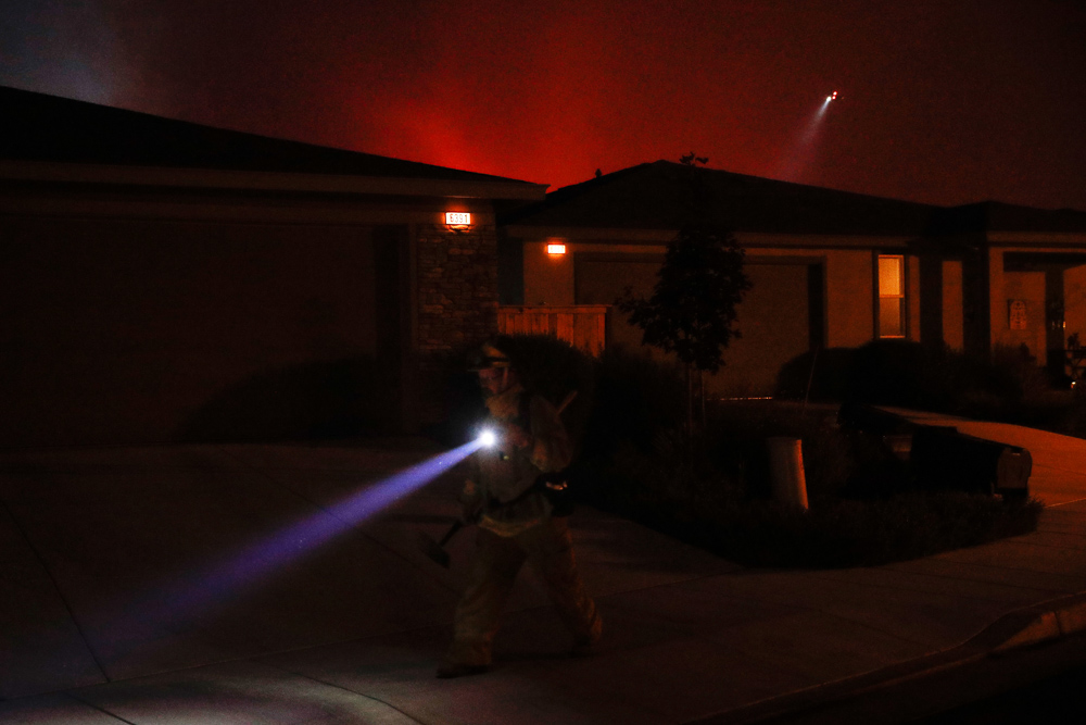 <div class='meta'><div class='origin-logo' data-origin='none'></div><span class='caption-text' data-credit='Jae C. Hong/AP Photo'>A firefighter looks for flammable items in an evacuated residential area as wildfires continue to burn in Santa Rosa, Calif.   Fire officials have ordered mandatory evacuations.</span></div>