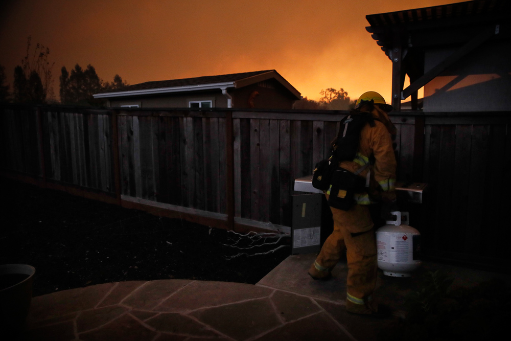 "<div class=""meta image-caption""><div class=""origin-logo origin-image none""><span>none</span></div><span class=""caption-text"">A firefighter removes a propane gas tank in an evacuated residential area as wildfires continue to burn Saturday, Oct. 14, 2017, in Santa Rosa, Calif. (Jae C. Hong/AP Photo)</span></div>"