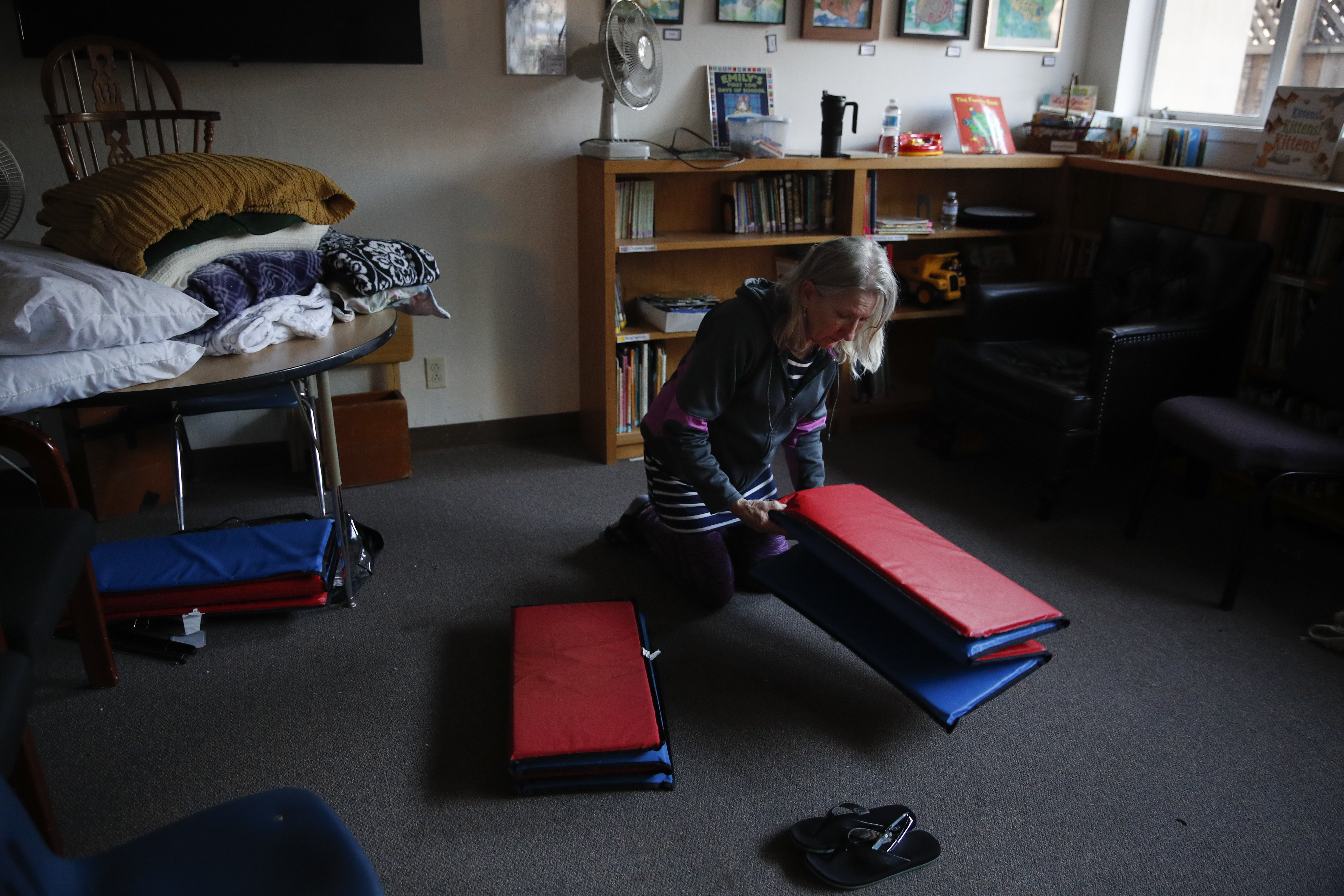 <div class='meta'><div class='origin-logo' data-origin='none'></div><span class='caption-text' data-credit='Jae C. Hong/AP Photo'>Wildfire evacuee Janice Carrman, 69, folds a mat she sleeps on at the First United Methodist Church that doubles as an evacuation shelter Sunday, Oct. 15, in Santa Rosa, Calif.</span></div>