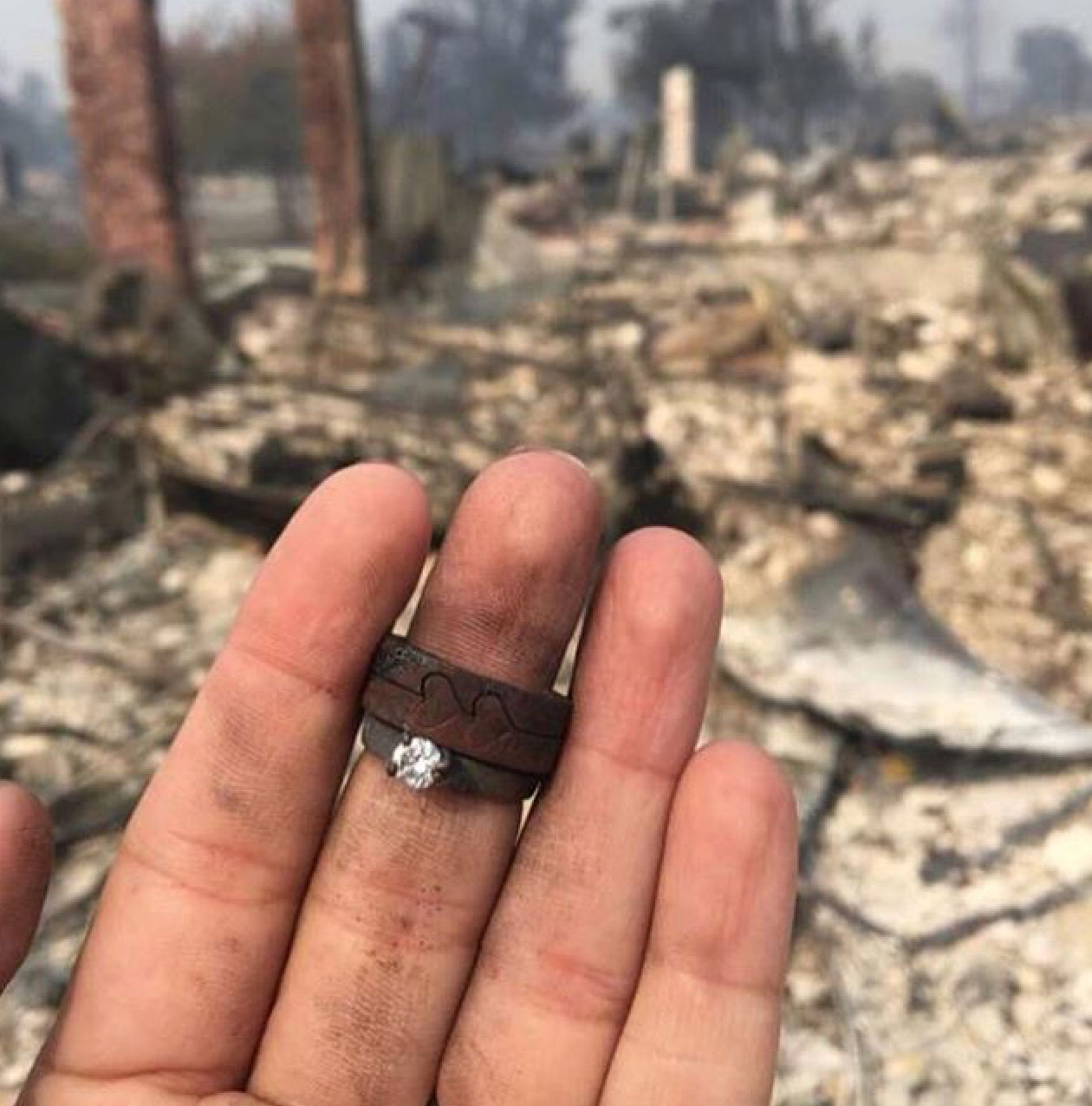 "<div class=""meta image-caption""><div class=""origin-logo origin-image none""><span>none</span></div><span class=""caption-text"">These rings were found in the rubble of a home, the person who took the photo said. It was captioned, ''Today, tomorrow, and everyday after that you need to love harder...'' (djgraystone/Instagram)</span></div>"