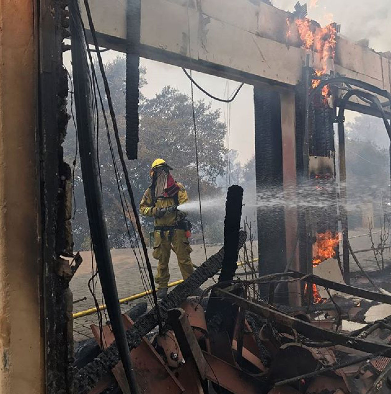 "<div class=""meta image-caption""><div class=""origin-logo origin-image none""><span>none</span></div><span class=""caption-text"">CalFire shared this photo of a firefighter in action. (calfire/Instagram)</span></div>"