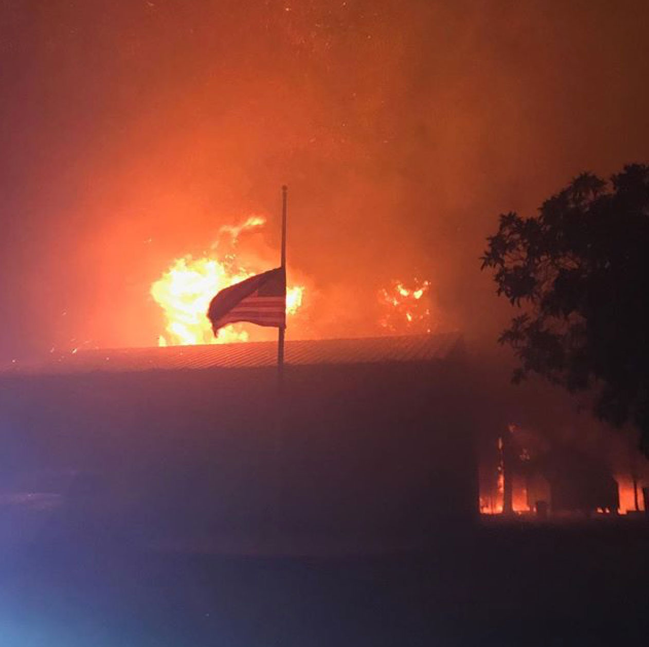 <div class='meta'><div class='origin-logo' data-origin='none'></div><span class='caption-text' data-credit='local55oakland/Instagram'>An American flag flies as the Tubbs fire burns behind it.</span></div>