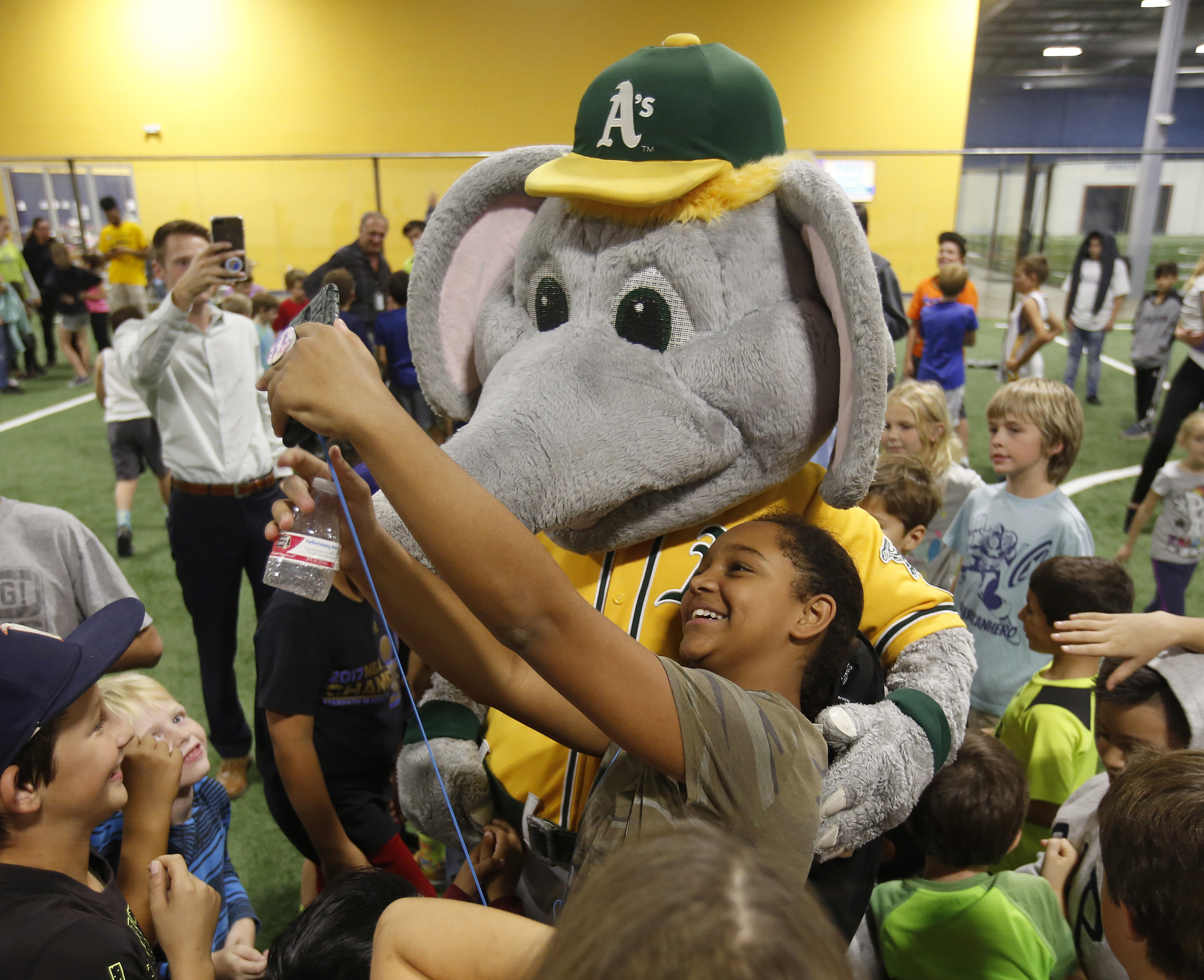 <div class='meta'><div class='origin-logo' data-origin='none'></div><span class='caption-text' data-credit='Rich Pedroncelli/AP Photo'>Deja Jones, 12, takes a selfie with Stomper, the mascot of the Oakland A's Major League Baseball team at an event for children affected by the wildfires, Oct. 17, in Santa Rosa.</span></div>