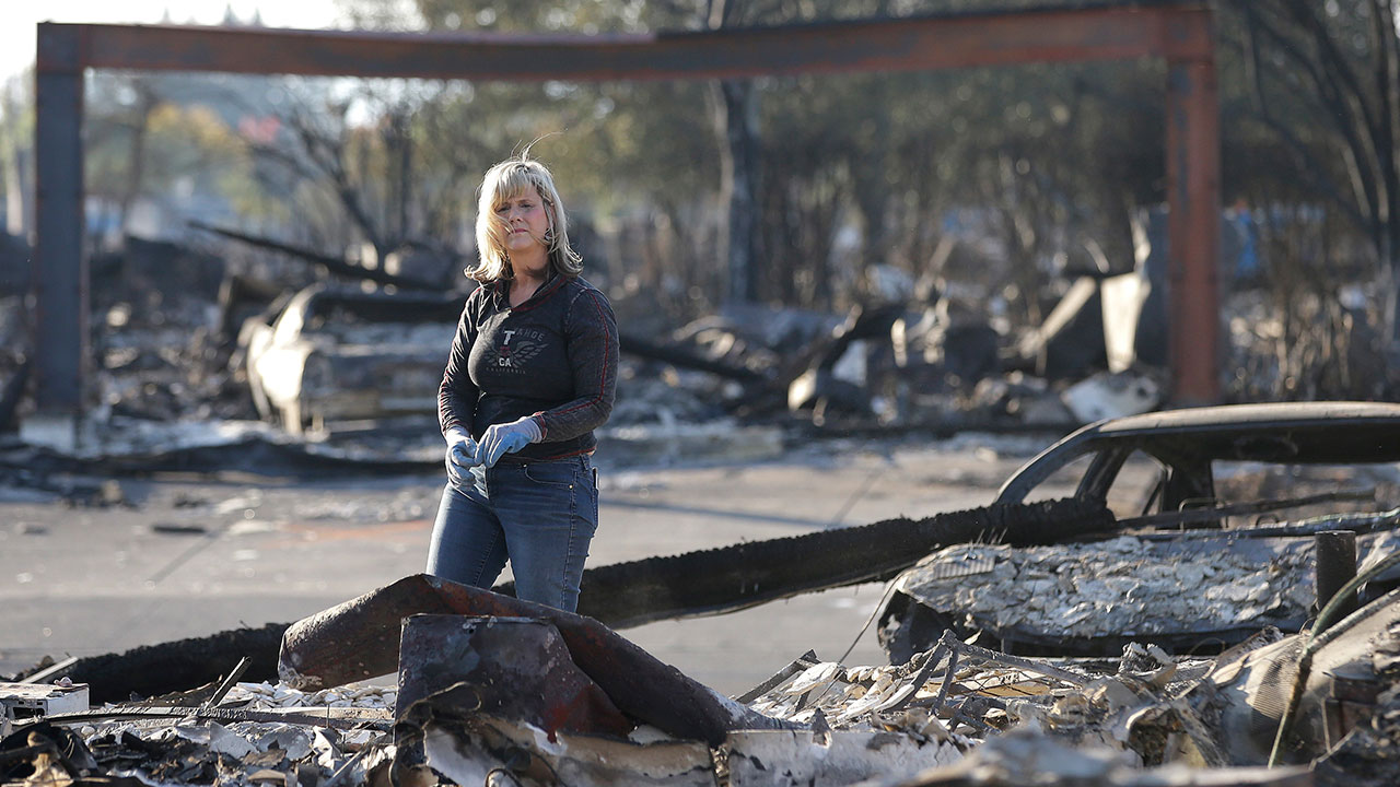 <div class='meta'><div class='origin-logo' data-origin='none'></div><span class='caption-text' data-credit='Rich Pedroncelli/AP Photo'>Debbie Wolfe looks over the burned ruins of her home of 30 years Tuesday, Oct. 17, 2017, in Santa Rosa, Calif.</span></div>