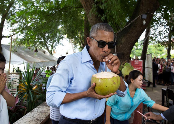 <div class='meta'><div class='origin-logo' data-origin='none'></div><span class='caption-text' data-credit='Pete Souza, Chief Official White House Photographer'>The president enjoying a drink from a coconut in Laos in 2016.</span></div>