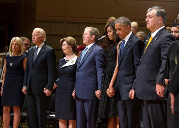 <div class='meta'><div class='origin-logo' data-origin='none'></div><span class='caption-text' data-credit='Pete Souza, Chief Official White House Photographer'>The Obamas with former president George W. Bush, Laura Bush, Vice President Joe Biden and Dr. Jill Biden, at a memorial service to honor fallen police officers in 2016.</span></div>