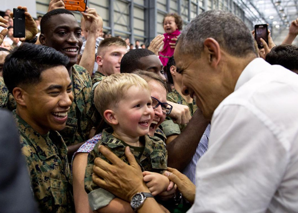 <div class='meta'><div class='origin-logo' data-origin='none'></div><span class='caption-text' data-credit='Pete Souza, Chief Official White House Photographer'>President Obama smiling as he meets a toddler while visiting the Marine Corps Air Station in Iwakuni, Japan.</span></div>