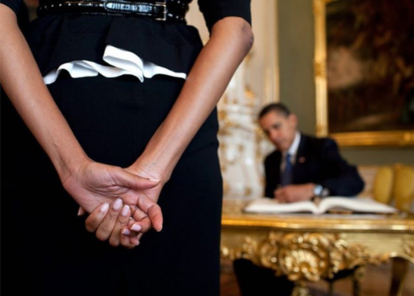<div class='meta'><div class='origin-logo' data-origin='none'></div><span class='caption-text' data-credit='Pete Souza, Chief Official White House Photographer'>An image of Michelle Obama and Barack Obama at the Prague Castle in 2009, with focus on the first lady's hands as the president signs the castle's guest book.</span></div>