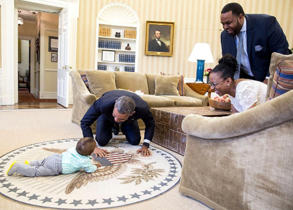 <div class='meta'><div class='origin-logo' data-origin='none'></div><span class='caption-text' data-credit='Pete Souza, Chief Official White House Photographer'>The president gets on all fours to play with the child of a former White House official in the Oval Office in 2016.</span></div>