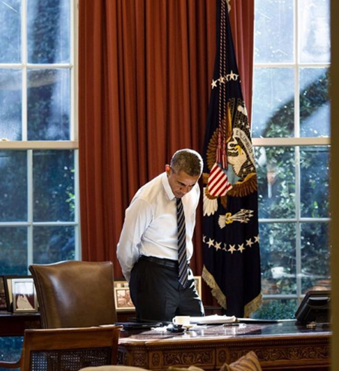 <div class='meta'><div class='origin-logo' data-origin='none'></div><span class='caption-text' data-credit='Pete Souza, Chief Official White House Photographer'>President Obama looking at items on his desk, illuminated by light coming in through the window in 2016.</span></div>