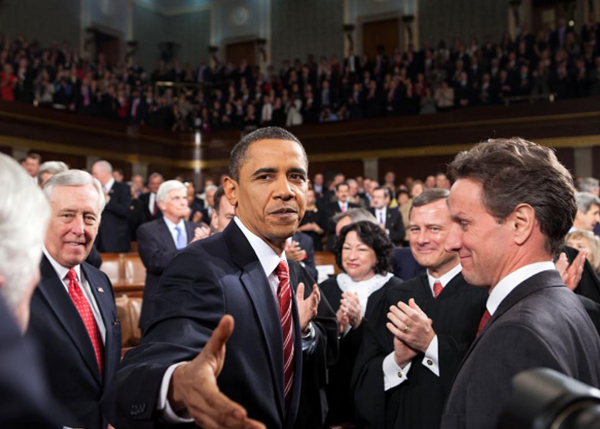<div class='meta'><div class='origin-logo' data-origin='none'></div><span class='caption-text' data-credit='Pete Souza, Chief Official White House Photographer'>President Obama with his hand outstretched towards Souza's camera while on the floor of the House of Representatives in 2010.</span></div>