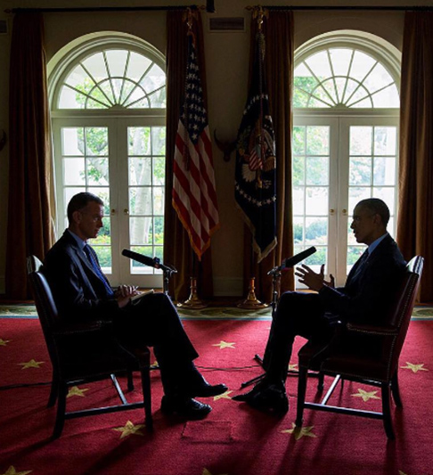 <div class='meta'><div class='origin-logo' data-origin='none'></div><span class='caption-text' data-credit='Pete Souza, Chief Official White House Photographer'>This dimly-lit image shows the president in an interview with Steve Inskeep of NPR in the White House's Cabinet room in 2015.</span></div>