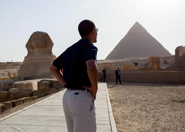 <div class='meta'><div class='origin-logo' data-origin='none'></div><span class='caption-text' data-credit='Pete Souza, Chief Official White House Photographer'>A photo of the president from behind as he toured Egypt in 2009.</span></div>