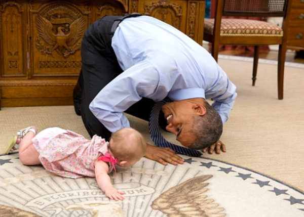 <div class='meta'><div class='origin-logo' data-origin='none'></div><span class='caption-text' data-credit='Pete Souza, Chief Official White House Photographer'>The president tilting his head to get a close-up view of the adorable daughter of Deputy National Security Advisor Ben Rhodes in 2015.</span></div>