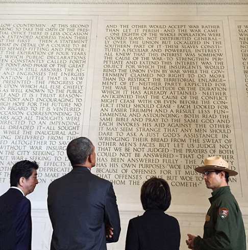 <div class='meta'><div class='origin-logo' data-origin='none'></div><span class='caption-text' data-credit='Pete Souza, Chief Official White House Photographer'>An image of President Obama from behind standing next to Japan's prime minister as they look at President Lincoln's second inaugural address at the Lincoln Memorial in 2015.</span></div>