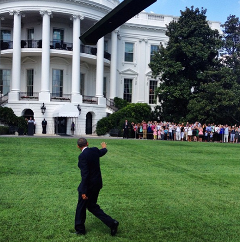 <div class='meta'><div class='origin-logo' data-origin='none'></div><span class='caption-text' data-credit='Pete Souza, Chief Official White House Photographer'>President Obama walking on the South Lawn of the White House while waving at a crowd.</span></div>
