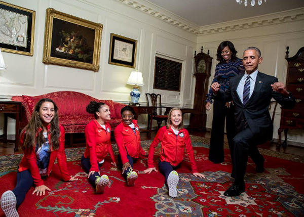 <div class='meta'><div class='origin-logo' data-origin='none'></div><span class='caption-text' data-credit='Pete Souza, Chief Official White House Photographer'>President Obama hanging out with the 2016 U.S. Olympic Women's Gymnastics Team as the first lady  smiles in the background.</span></div>