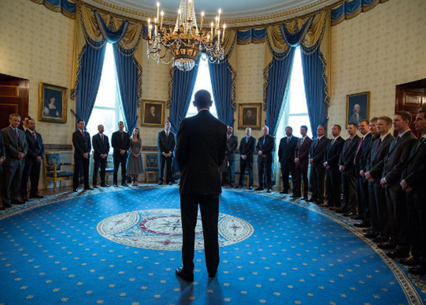 <div class='meta'><div class='origin-logo' data-origin='none'></div><span class='caption-text' data-credit='Pete Souza, Chief Official White House Photographer'>An image of President Obama from behind as he meets NASCAR driver Kyle Busch and his team to honor Busch's 2015 Sprint Cup Series championship.</span></div>