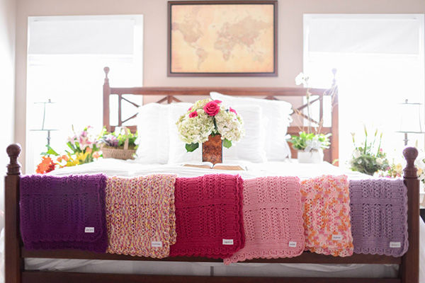 "<div class=""meta image-caption""><div class=""origin-logo origin-image ""><span></span></div><span class=""caption-text"">Blankets knit for each of the six girls by a member of the Justice's church. (Justice Family)</span></div>"