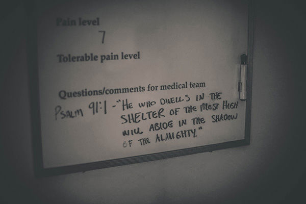 "<div class=""meta image-caption""><div class=""origin-logo origin-image ""><span></span></div><span class=""caption-text"">A psalm written on a hospital whiteboard the day Lindsey gave birth. (Justice Family)</span></div>"