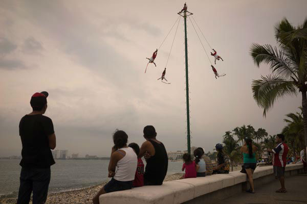 <div class='meta'><div class='origin-logo' data-origin='none'></div><span class='caption-text' data-credit='AP Photo/ Cesar Rodriguez'>People watch as Papantla Flyers perform on the seafront in the Pacific resort city of Puerto Vallarta, Mexico, Thursday, Oct. 22, 2015.</span></div>