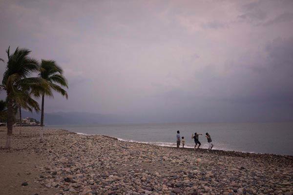 <div class='meta'><div class='origin-logo' data-origin='none'></div><span class='caption-text' data-credit='AP Photo/ Cesar Rodriguez'>People throw stones into the ocean as hurricane Patricia nears in the Pacific resort city of Puerto Vallarta, Mexico, Thursday, Oct. 22, 2015.</span></div>