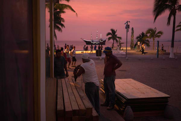 <div class='meta'><div class='origin-logo' data-origin='none'></div><span class='caption-text' data-credit='AP Photo/ Cesar Rodriguez'>People preparing for the arrival of hurricane Patricia board up the windows of a seaside business in the Pacific resort city of Puerto Vallarta, Mexico, Thursday, Oct. 22, 2015.</span></div>