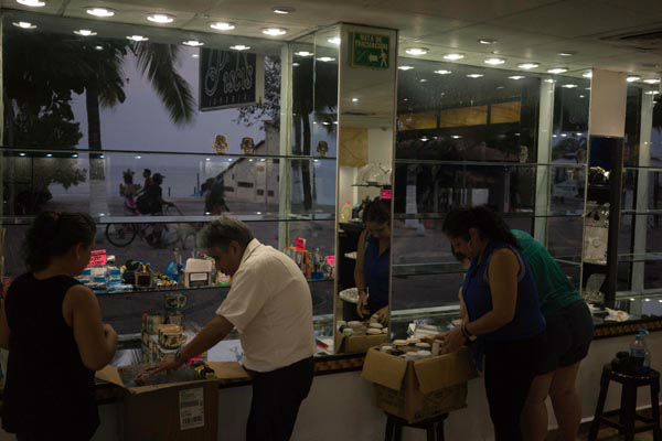 <div class='meta'><div class='origin-logo' data-origin='none'></div><span class='caption-text' data-credit='AP Photo/ Cesar Rodriguez'>People preparing for the arrival of hurricane Patricia box their merchandise at a seafront jewelry shop in the Pacific resort city of Puerto Vallarta, Mexico.</span></div>