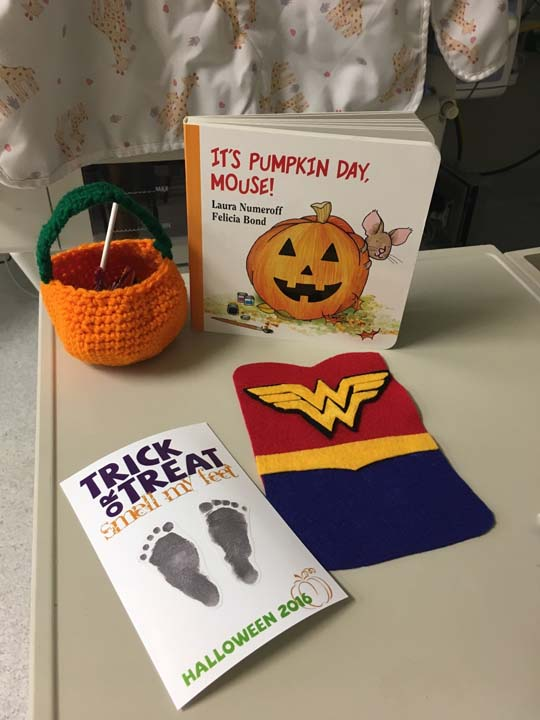 "<div class=""meta image-caption""><div class=""origin-logo origin-image wpvi""><span>wpvi</span></div><span class=""caption-text"">In addition to the costumes, the babies received a footprint card, a crocheted pumpkin for candy, and a Halloween book (Saint Luke's Hospital)</span></div>"