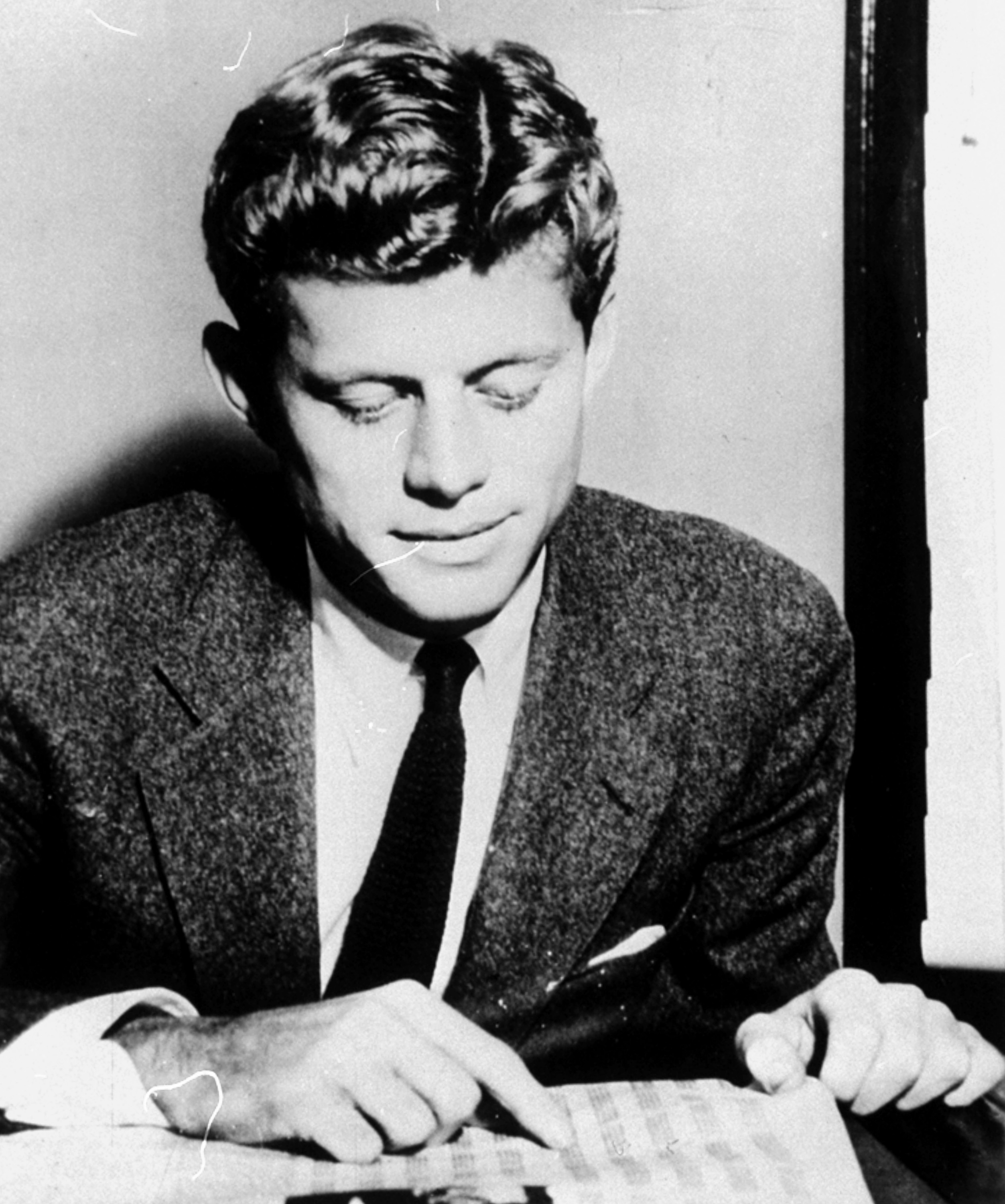 <div class='meta'><div class='origin-logo' data-origin='none'></div><span class='caption-text' data-credit='ASSOCIATED PRESS'>John F. Kennedy is pictured as a 23-year-old graduate student at Stanford University, Palo Alto, California, in October 1940.  He had graduated Harvard in June.</span></div>
