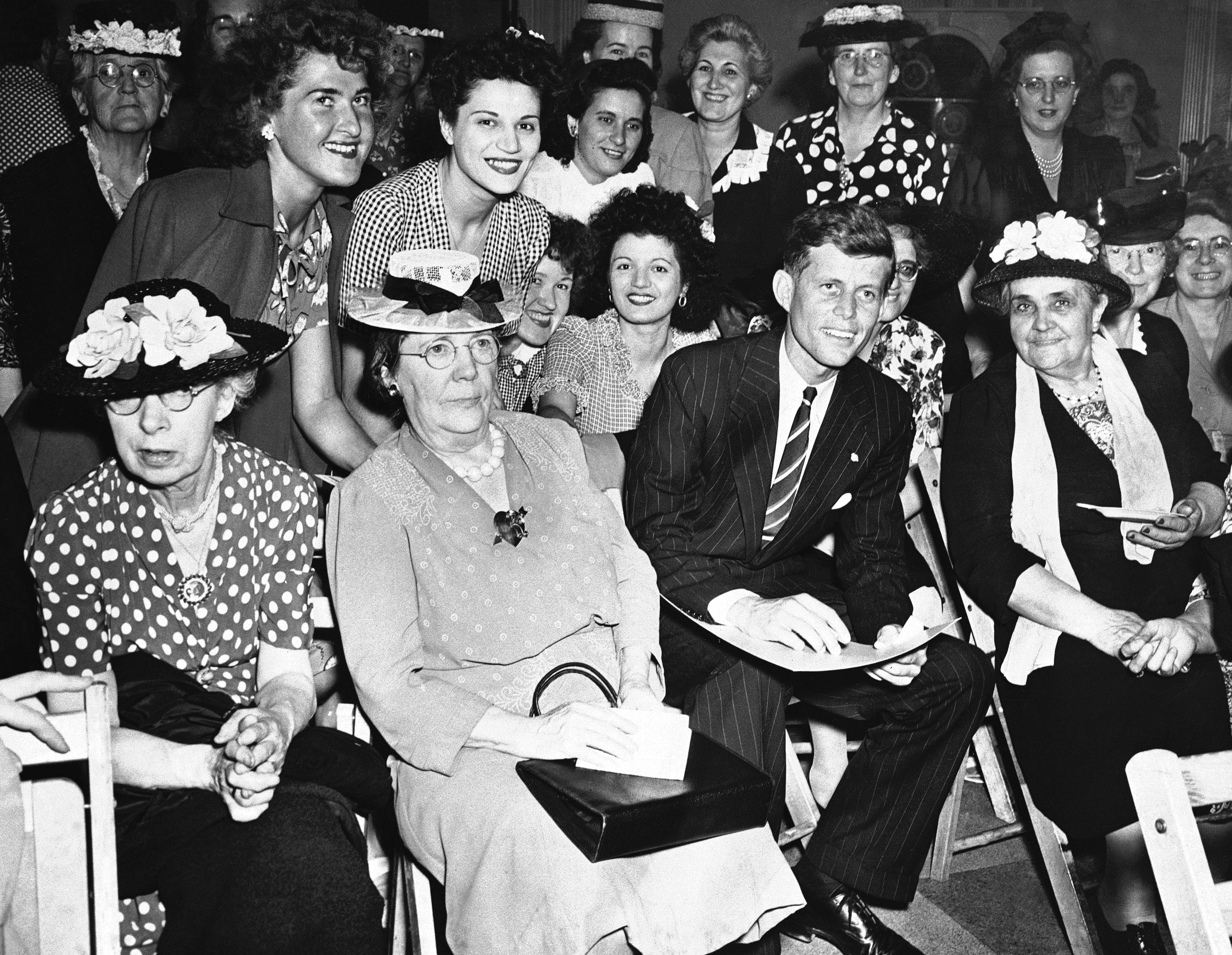 <div class='meta'><div class='origin-logo' data-origin='none'></div><span class='caption-text' data-credit='ASSOCIATED PRESS'>John F. Kennedy surrounded by women voters during his first campaign for congress in 1946.</span></div>