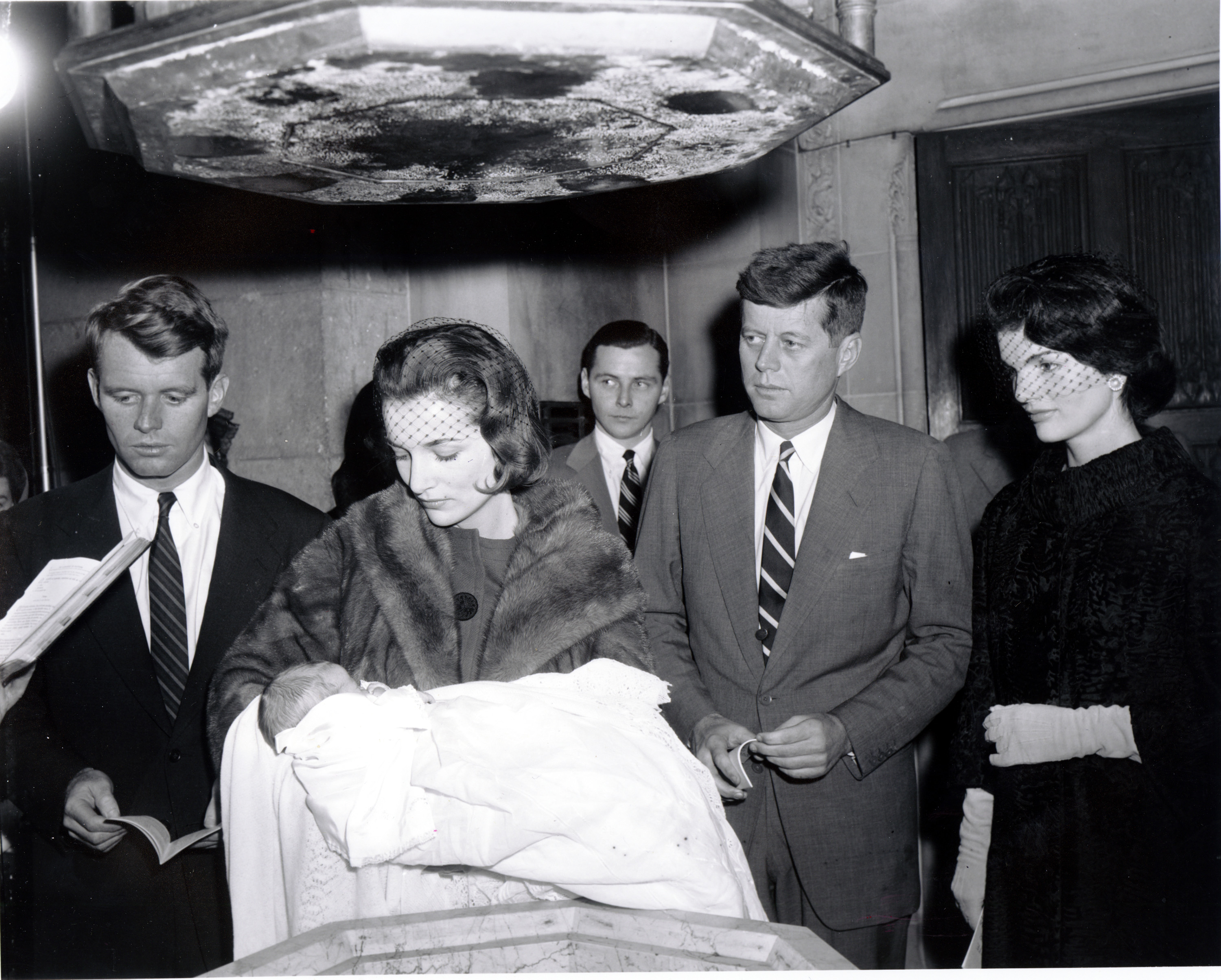 <div class='meta'><div class='origin-logo' data-origin='none'></div><span class='caption-text' data-credit='ASSOCIATED PRESS'>Sen. John Kennedy, D-Mass., and his wife, Jacqueline Kennedy, watch as her sister holds their 15-day-old daughter during her christening in New York City on Dec. 13, 1957.</span></div>