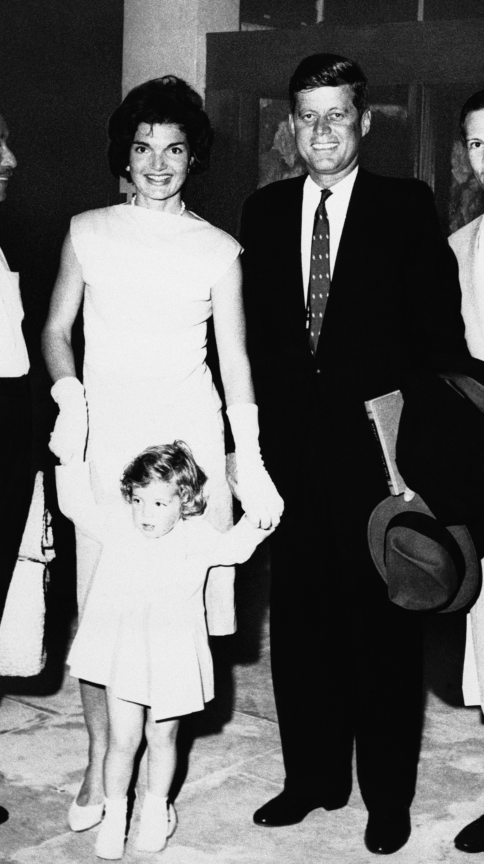 <div class='meta'><div class='origin-logo' data-origin='none'></div><span class='caption-text' data-credit='ASSOCIATED PRESS'>Senator John F. Kennedy (D-Mass.) arrives with his wife Jacqueline and their 2-year-old daughter Caroline at Montego Bay Airport, Jamaica on Dec. 24, 1959 for a 12-day vacation.</span></div>