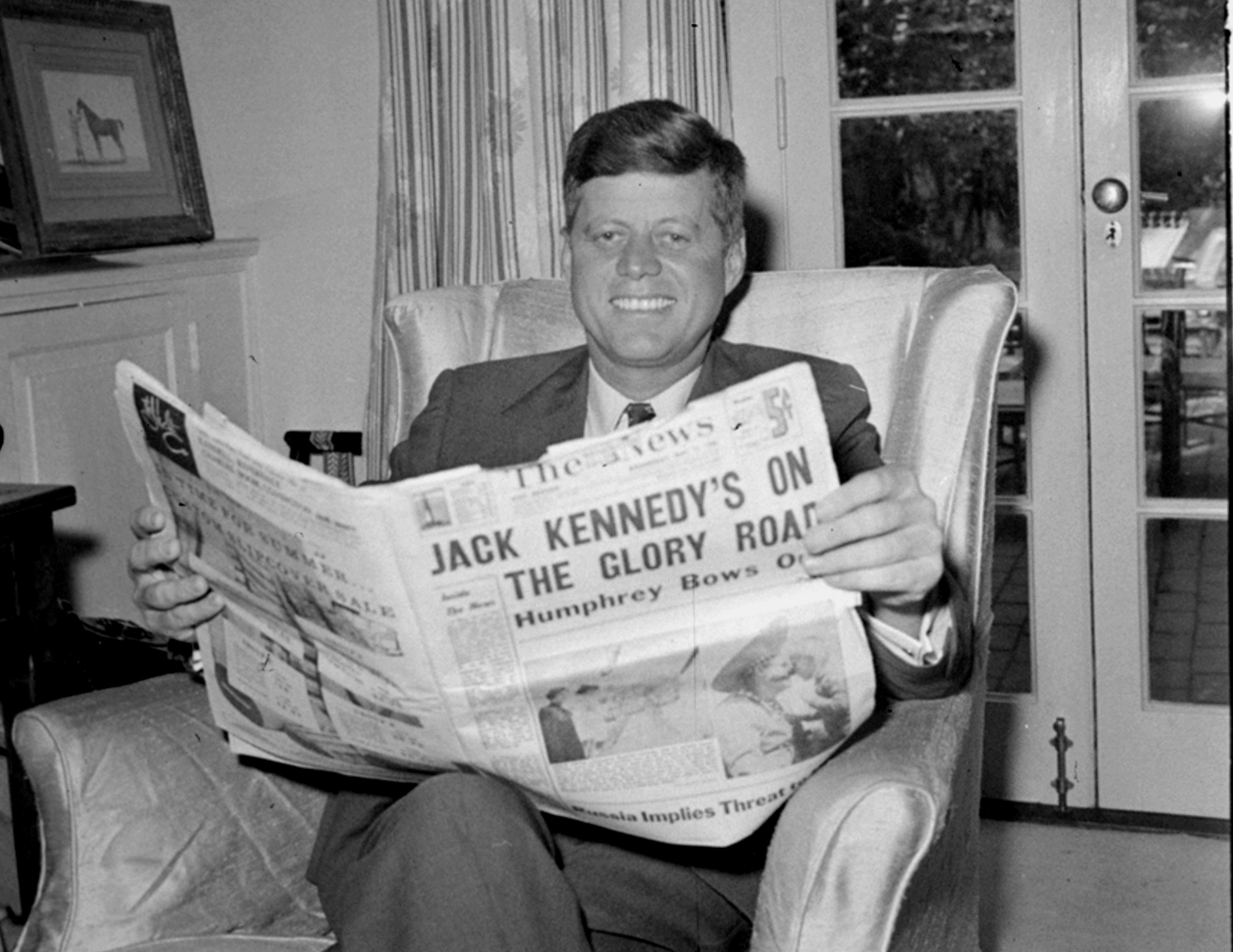 <div class='meta'><div class='origin-logo' data-origin='none'></div><span class='caption-text' data-credit='Henry Burroughs/AP Photo'>Sen. John F. Kennedy (D-MA) reads the daily newspaper accounts of his West Virginia election victory as he relaxes, May 11, 1960, in his Washington home.</span></div>