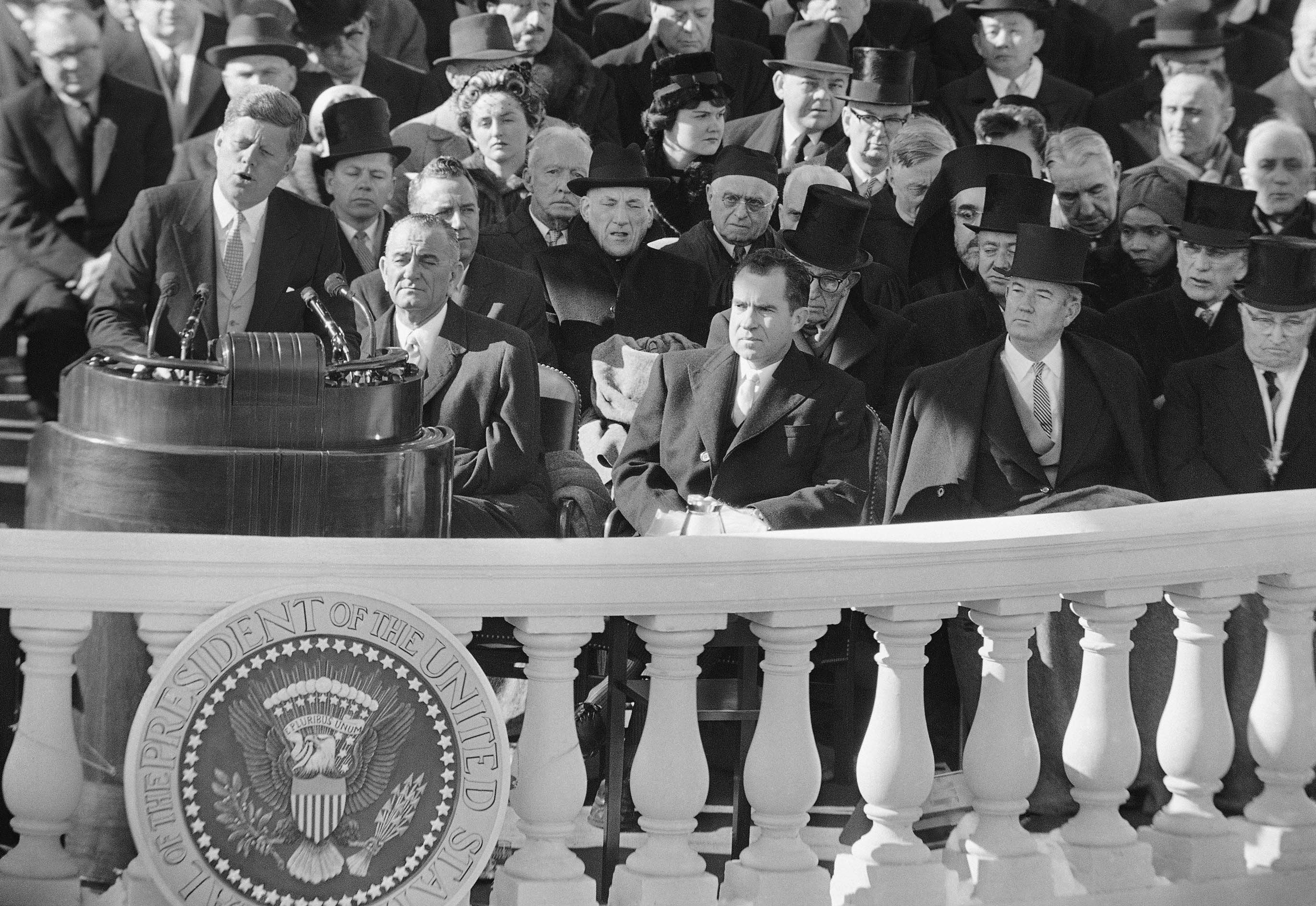 <div class='meta'><div class='origin-logo' data-origin='none'></div><span class='caption-text' data-credit='ASSOCIATED PRESS'>FILE - In this Jan. 20, 1961, black and white file photo,President John F. Kennedy gives his inaugural address at the Capitol in Washington after taking the oath of office.</span></div>