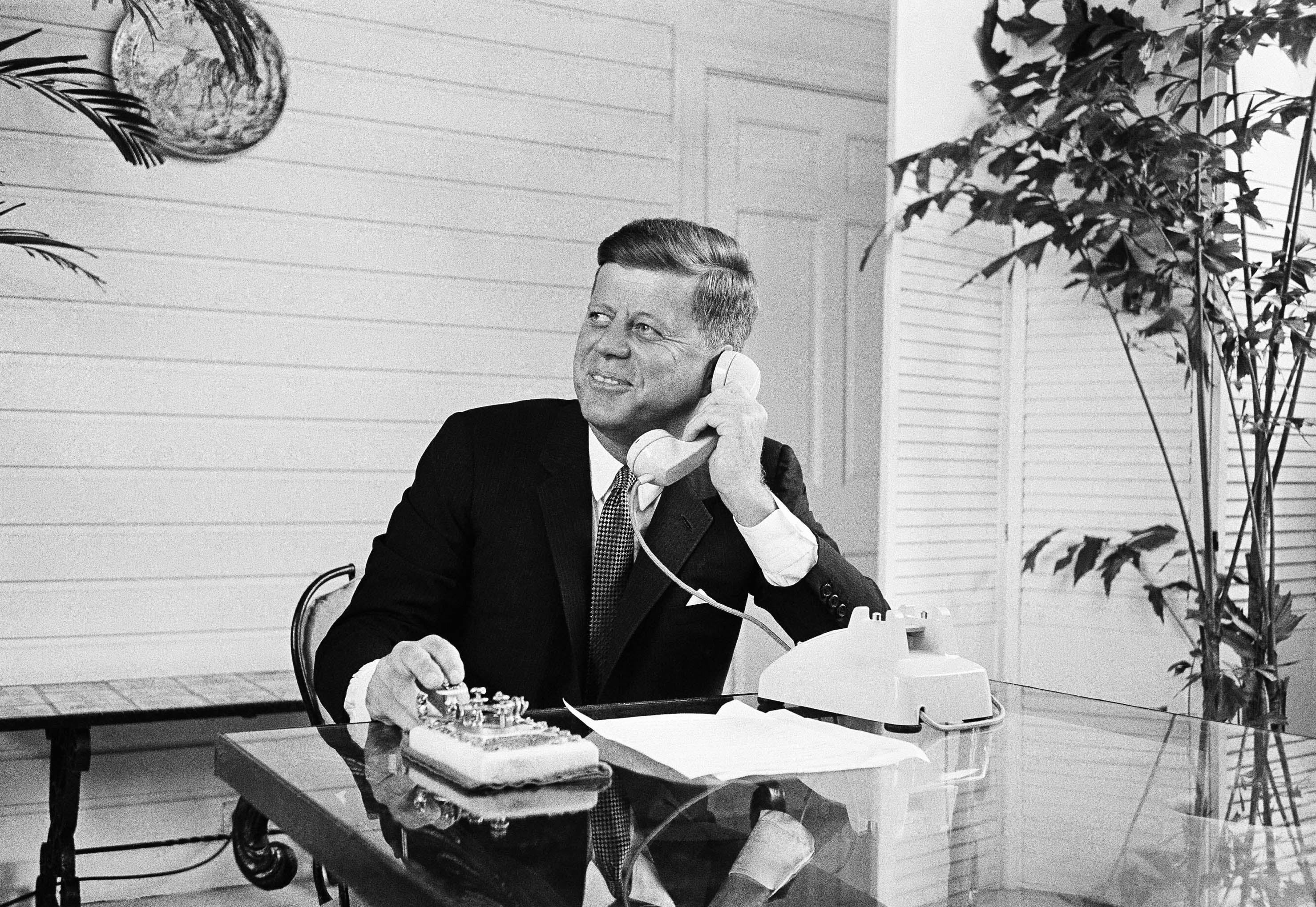 <div class='meta'><div class='origin-logo' data-origin='none'></div><span class='caption-text' data-credit='AP'>President Kennedy presses a gold telegraph key as he speaks over the telephone as part of the opening of the Seattle World's Fair in Palm Beach, Fla. on April 21, 1962.</span></div>