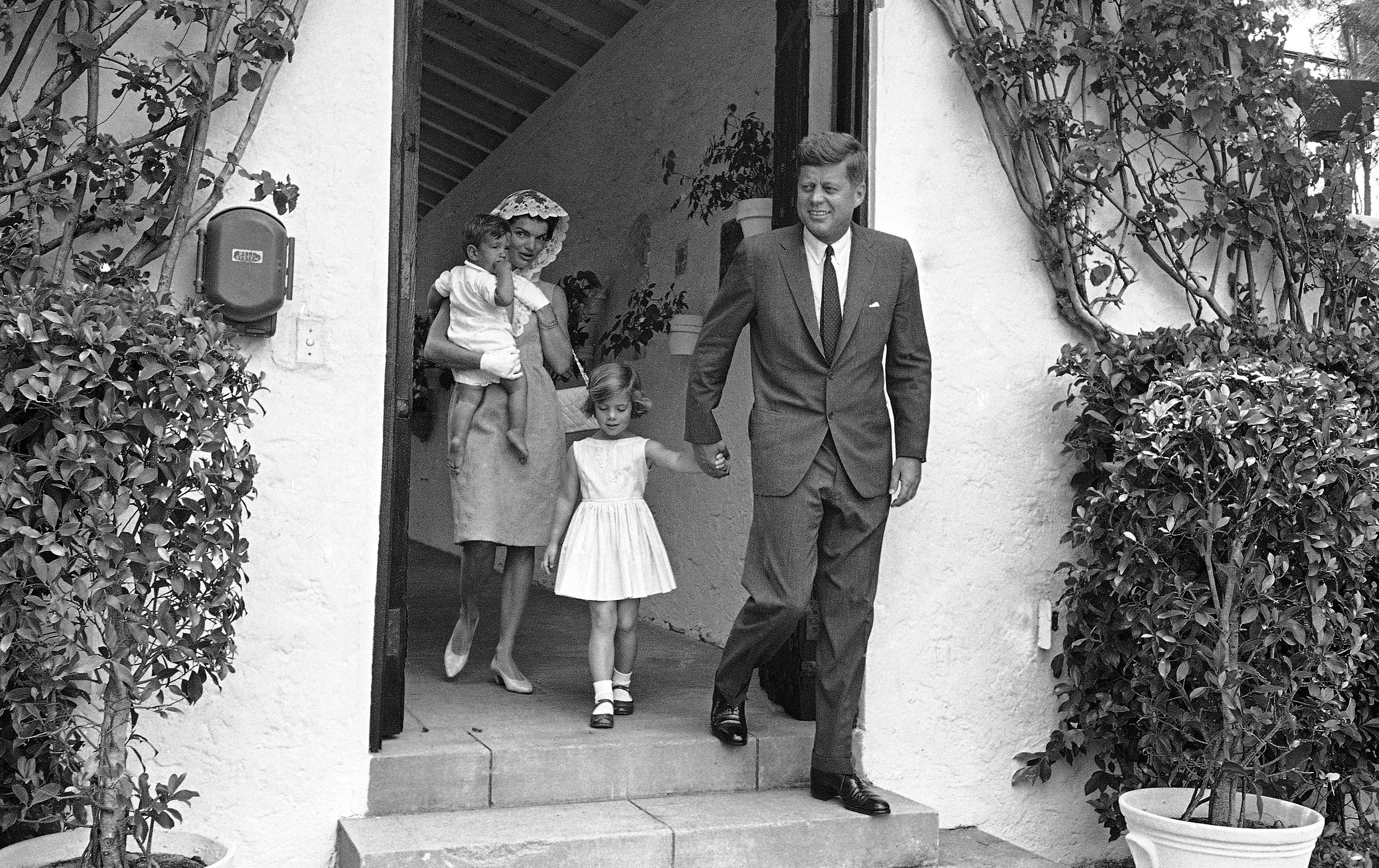 <div class='meta'><div class='origin-logo' data-origin='none'></div><span class='caption-text' data-credit='AP'>President John F. Kennedy, Jacqueline Kennedy and their children as they left a private family mass in Palm Beach, Florida on April 22, 1962.</span></div>