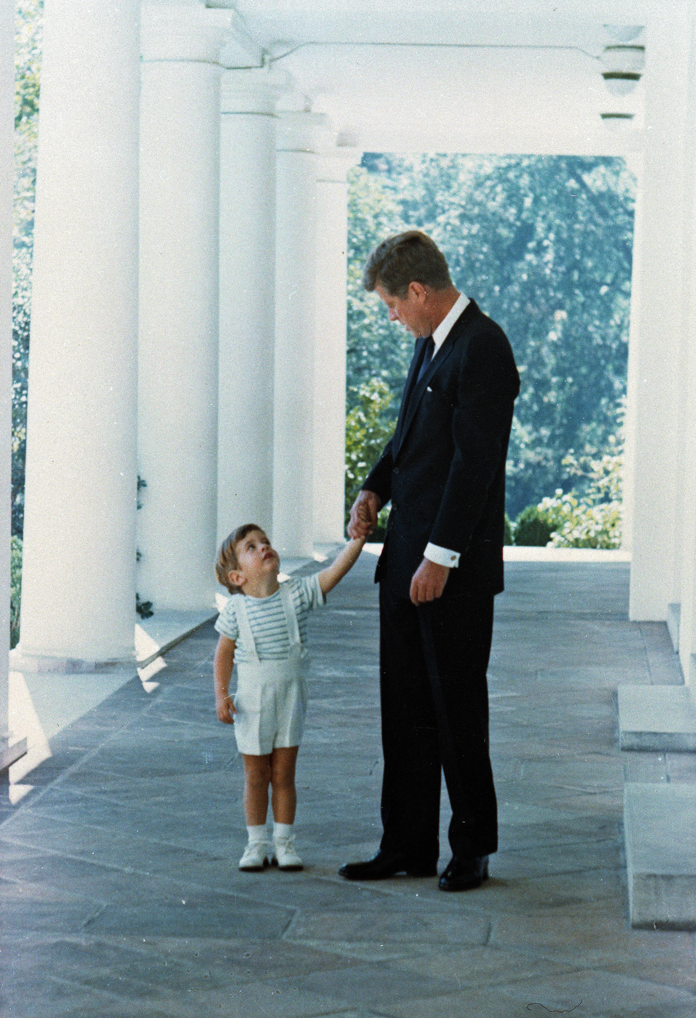 <div class='meta'><div class='origin-logo' data-origin='none'></div><span class='caption-text' data-credit='AP'>U.S. President John F. Kennedy is shown with his son, John Jr., as they hold hands outside the White House in Washington, D.C. circa 1963.</span></div>