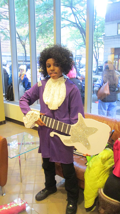 "<div class=""meta image-caption""><div class=""origin-logo origin-image none""><span>none</span></div><span class=""caption-text"">A young contestant dressed as late pop icon Prince poses with his guitar.</span></div>"