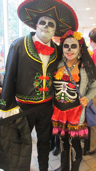 "<div class=""meta image-caption""><div class=""origin-logo origin-image none""><span>none</span></div><span class=""caption-text"">Audience members celebrate Dias de Muertos a day early with their costumes on the ''Live with Kelly'' Halloween special.</span></div>"