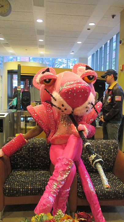 "<div class=""meta image-caption""><div class=""origin-logo origin-image none""><span>none</span></div><span class=""caption-text"">A Pink Panther with a disco twist poses ahead of the ''Live with Kelly'' costume contest. The massive costume was among the top five finalists.</span></div>"