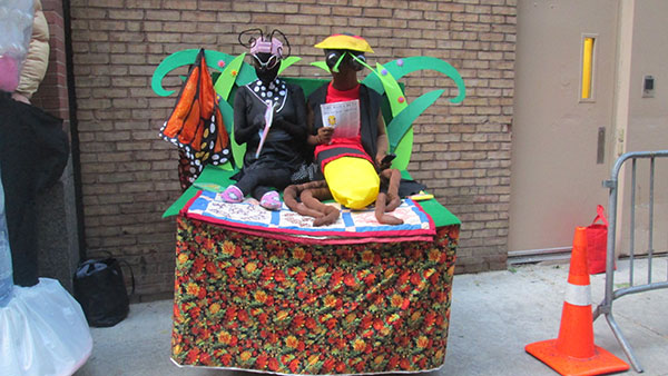 "<div class=""meta image-caption""><div class=""origin-logo origin-image none""><span>none</span></div><span class=""caption-text"">A pair of ""bed bugs"" relax outside the ''Live with Kelly'' studio. They were among the finalists in the costume contest.</span></div>"