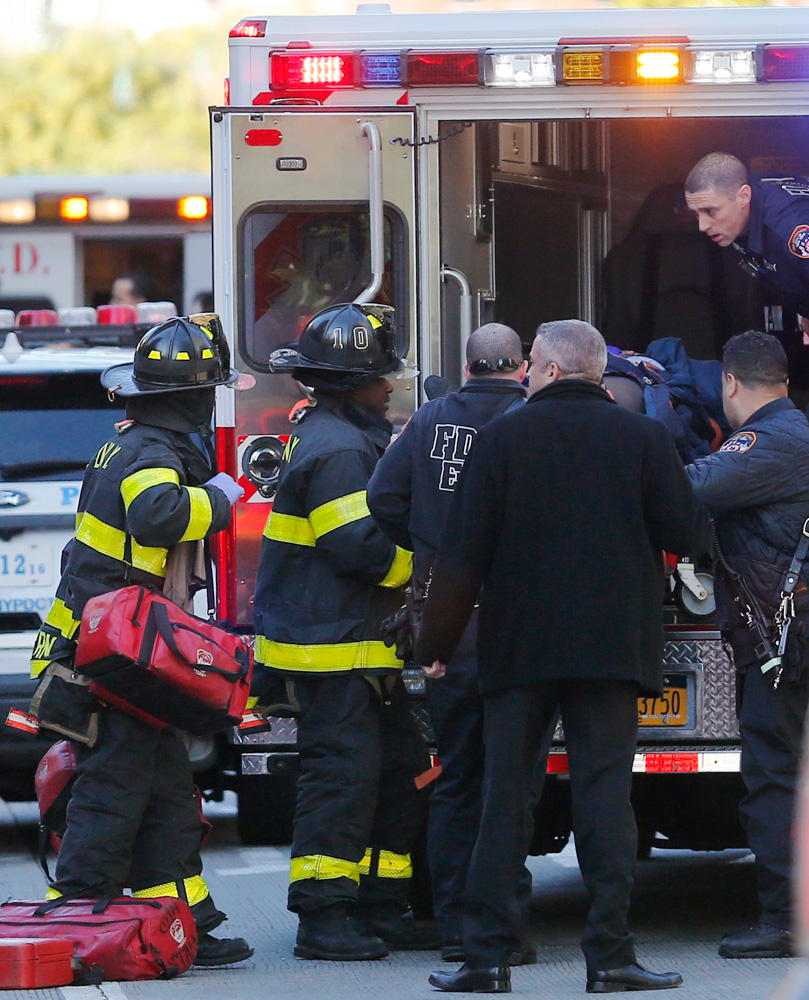 <div class='meta'><div class='origin-logo' data-origin='none'></div><span class='caption-text' data-credit='Bebeto Matthews/AP Photo'>Paramedics lift an individual into an ambulance near the scene after reports of a deadly shooting Tuesday Oct. 31, 2017, in New York.</span></div>