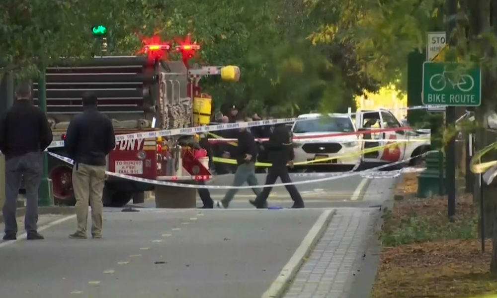 <div class='meta'><div class='origin-logo' data-origin='none'></div><span class='caption-text' data-credit='AP Photo'>Police and ambulances respond after a motorist drove onto a busy bicycle path near the World Trade Center memorial and struck and killed several people Tuesday, Oct. 31, 2017.</span></div>