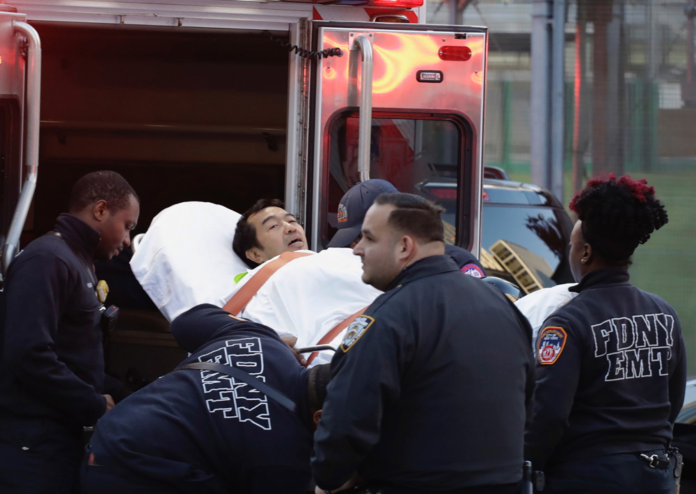 <div class='meta'><div class='origin-logo' data-origin='none'></div><span class='caption-text' data-credit='Mark Lennihan/AP Photo'>Emergency personnel carry a man into an ambulance after a motorist drove onto a busy bicycle path near the World Trade Center memorial and struck several people Oct. 31, 2017.</span></div>