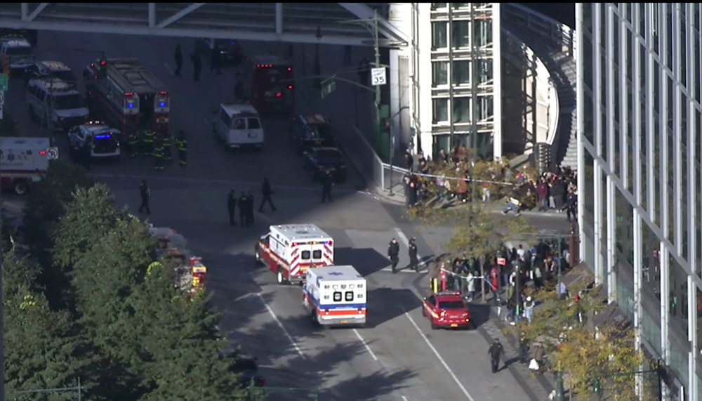 <div class='meta'><div class='origin-logo' data-origin='none'></div><span class='caption-text' data-credit='AP Photo'>In this still image taken from video, police and ambulances respond to report of gunfire a few blocks from the World Trade Center in New York on Tuesday, Oct. 31, 2017.</span></div>