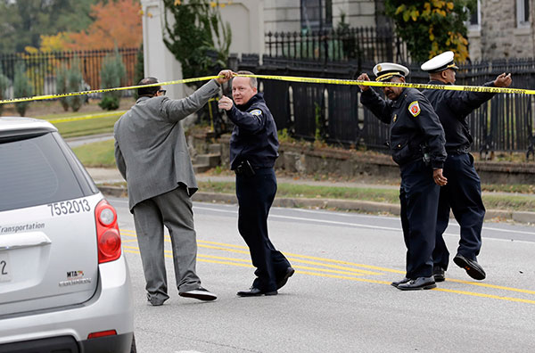 "<div class=""meta image-caption""><div class=""origin-logo origin-image none""><span>none</span></div><span class=""caption-text"">Baltimore Police Department commissioner Kevin Davis, second from left, approaches the scene of an early morning fatal collision between a school bus and a commuter bus. (Patrick Semansky/AP Photo)</span></div>"