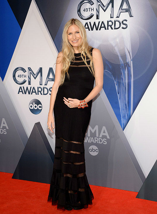 <div class='meta'><div class='origin-logo' data-origin='none'></div><span class='caption-text' data-credit='Evan Agostini/Invision/AP'>Holly Williams arrives at the 49th annual CMA Awards at the Bridgestone Arena on Wednesday, Nov. 4, 2015, in Nashville, Tenn.</span></div>